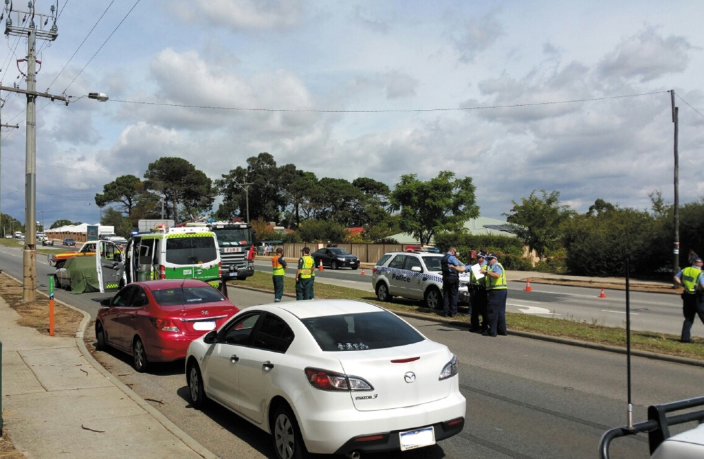 Police and emergency services at the scene of the crash. Picture: David Baylis.