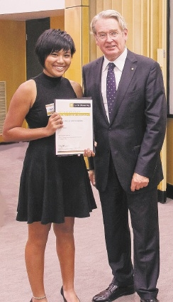 April Htun receives her camp graduation certificate from former WA Premier Richard Court.