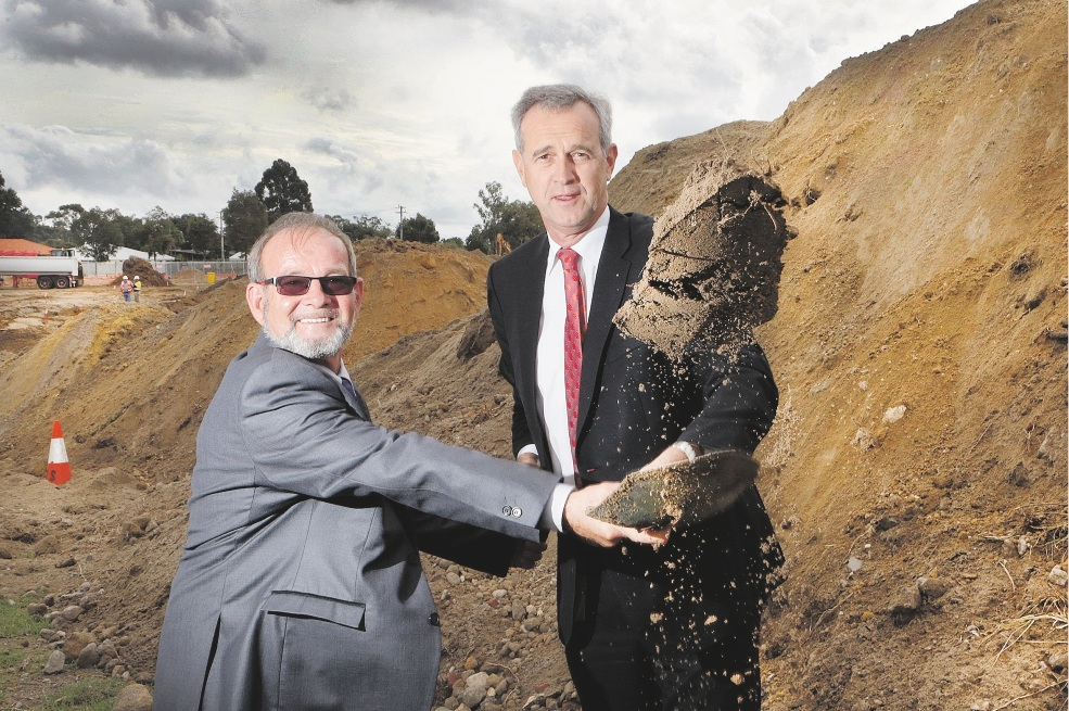 Local Government Minister Tony Simpson turns the first sod at the Mills Park redevelopment, with Gosnells Mayor Dave Griffiths.