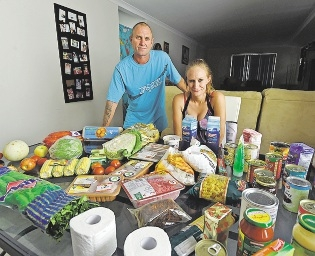 Simon and Cheyenne Taylor with hamper items.