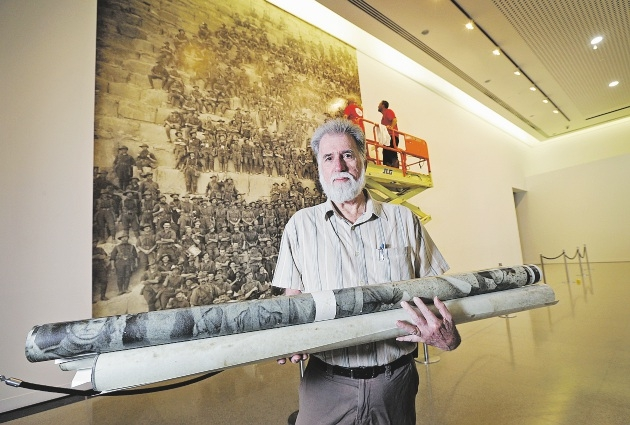 WA Genealogical Society project manager Chris Loudon stands in front of an image of some of the men from the 11th Battalion.  Picture: David Baylis        www.communitypix.com.au   d435358