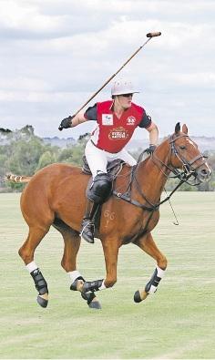 Garrett Prendiville prepares for Polo in the Valley.     d435838