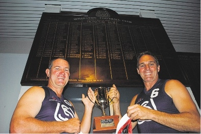 Chris Pobjoy (League Assistant) and Paul Kujawski (Colts Coach) wearing their original Willetton Football Club jumpers.
