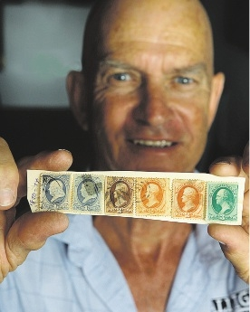 Vin Nairn with some of the early American stamps dated 1857.