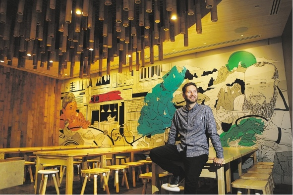 Architect Evan Reeves looks over his designs at Bam Bam Boo. Picture: Andrew Ritchie        d435836