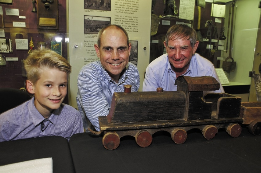Campbell McConnell of Madeley (left) and Tapping resident Andrew Swanson (right) at the WA Museum with history curator Stephen Anstey and a toy train from the Museum's ECU Museum of Childhood collection.         Pictures: Jeff Atkinson