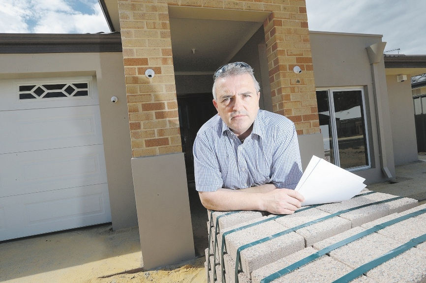 Chris Thompson waited two-and-a-half years for his new home. Picture: Marcelo Palacios www.communitypix.com.au   d435761