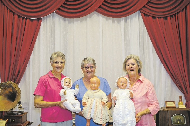 Sue Baker, Helen Greer and Diane Stewart with some vintage dolls. Picture: Martin Kennealey www.communitypix.com.au   d435368