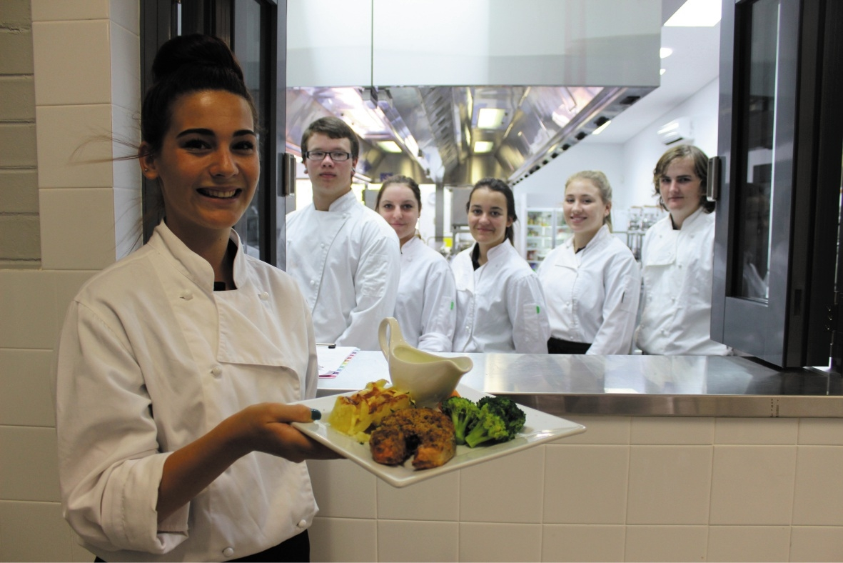 Students Shari Iabnez, Josh Rijntjes, Kate Hicks, Samantha Da Silva, Chelsea Brookes and Dylan Potter in Clarkson Community High School's commercial kitchen.