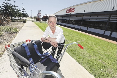 Sandy Roberts with the new disability trolley.