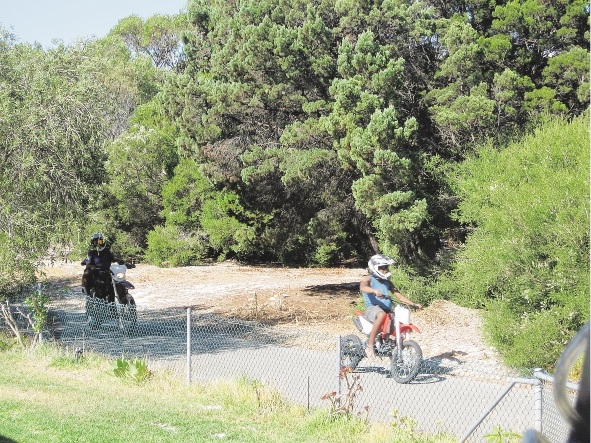 Off-road motorbike riders on a cycle path in Coogee.