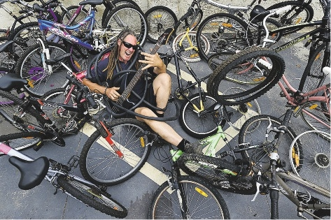 Heavy metal of a different ilk... former heavy metal muso Jeremy Devereux in a sea of bikes. Picture: Marcus Whisson         d434665