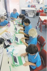 Yanchep District High School students using the laptops.