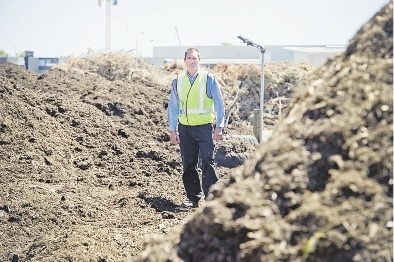 Supervisor Mark Bennett checking out the mulch at the Wangara Greens Recycling facility.
