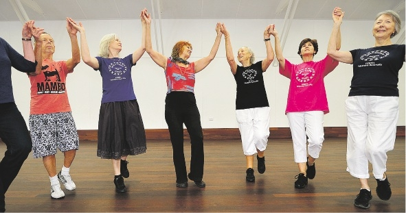 Hora Shalom founder Sara Friedman (centre in red) leads a class of Israeli dancers.