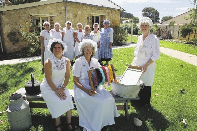 Catherine Murray, Doreen Savage, Jennifer Gee, at front, with other Buckingham House volunteers. The group was recently recognised with an Australia Day community group award. Picture: Emma Goodwin