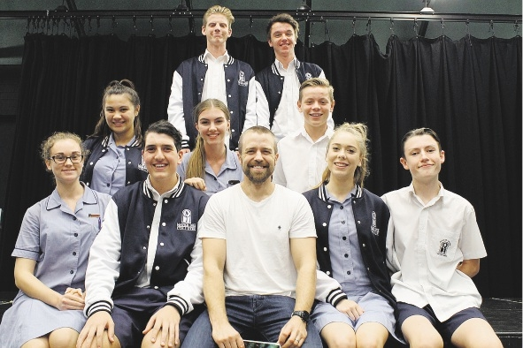 Simon Gleeson (front, centre) with cast from Mater Dei College's production of The Addams Family Musical.