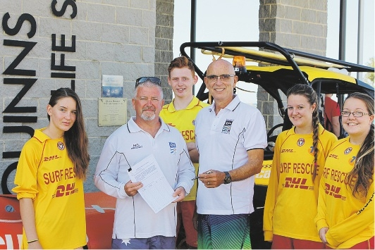 Butler MLA and club patron John Quigley meets with surf club members Brenna Jackson, Neil Rigby, Innes Lumsden, Rebekah Birch and Dana Birch.