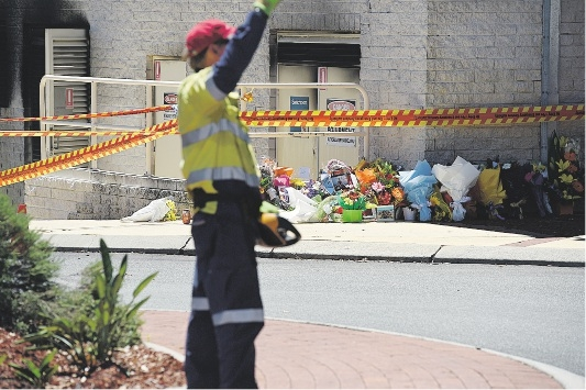 Flowers left at the scene of the fatal explosion at Morley Galleria Shopping Centre. Picture: Marcus Whisson