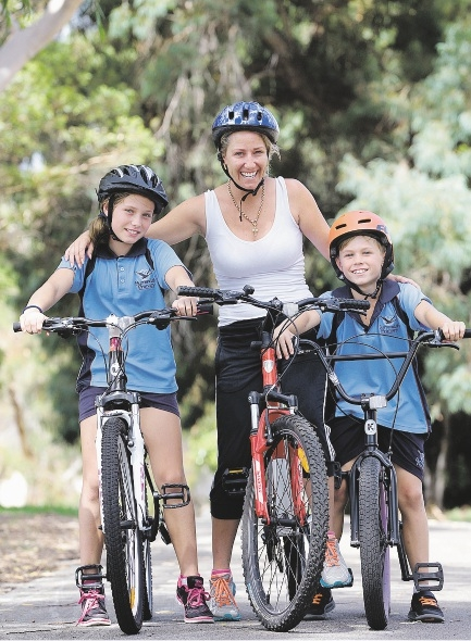 Tamra Morgan with children Holly (9) and Bailey (8) prepare for the Freeway Bike Hike.