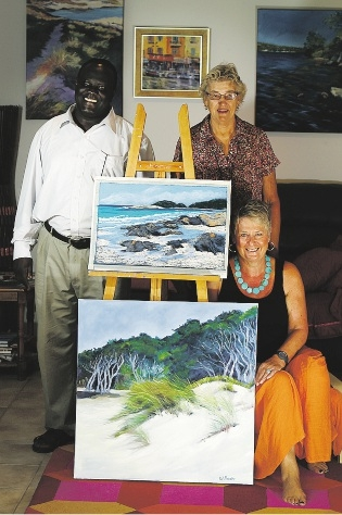 The reverend Onesimo Yugusuk, Moira |Cumberworth and Val Brooks promote the |upcoming exhibition.