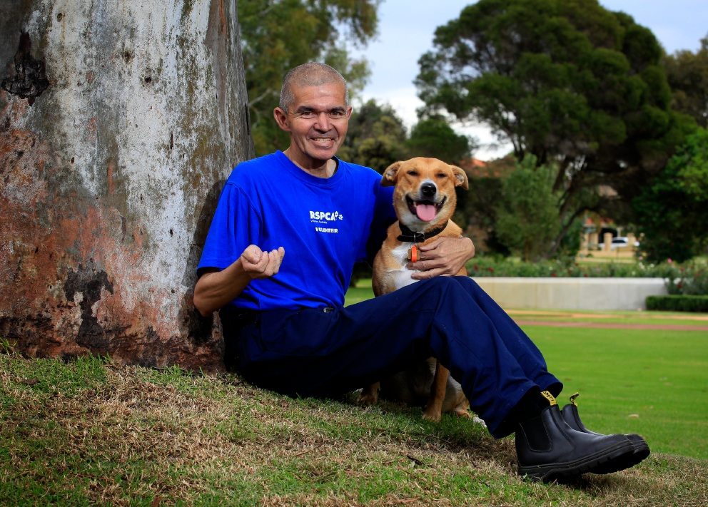 RSPCA volunteer Nigel D'Cruz with rescue dog Poppy. Picture: Marie Nirme d453649