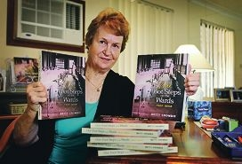 Retired nurse Betty Crombie with copies of Our Foot Steps on the Wards 1953-2003. Picture: David Baylis d428796