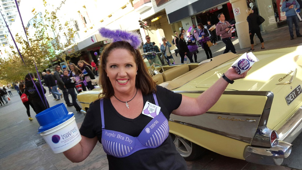 Rachel Fitzgerald shakes a tin at Purple Bra Day.