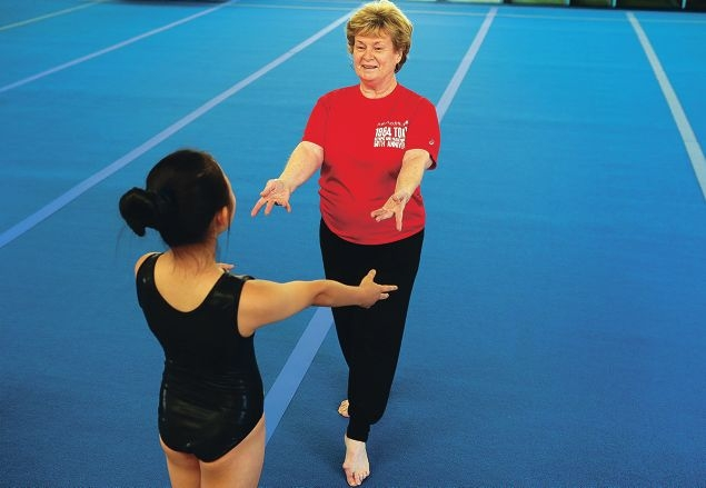Val Norris-Buffham works with gymnast Erina Hong.