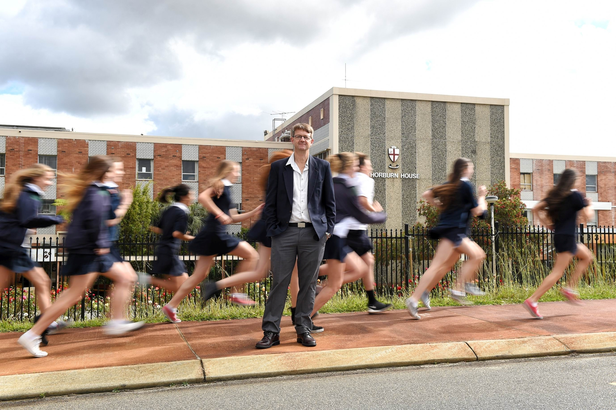 Shenton College board chairman Roger Castle and students outside the former Royal Perth Rehabilitation Hospital. Picture Marcus Whisson d427969