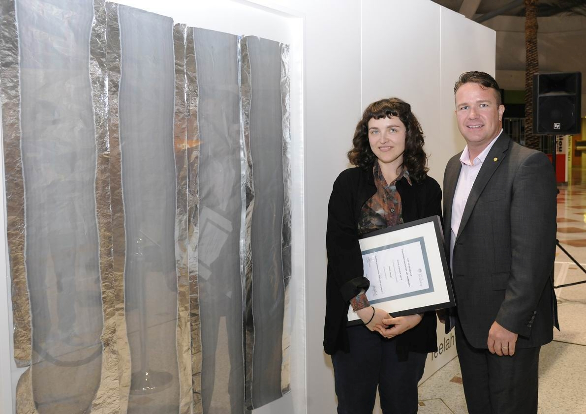 Teelah George in front of her art work with Joondalup Mayor Troy Pickard.