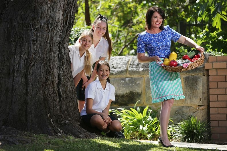 PLC students Emmanuelle Lee, Lucy Banks and Tian Kaelin with celebrity chef Anna Gare, preparing for the school's annual Open Garden Day. Picture: Andrew Ritchie www.communitypix.com.au d427739