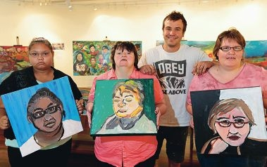 Artist Jacob Butler with Karla Little, Fiona McIlrath and Carolyn Jurgeds with their work for the exhibition. Picture: Martin Kennealey www.communitypix.com.au d427577