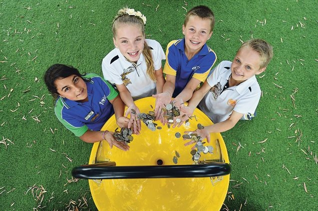 Lake Gwelup students, from left, Daniella Savva, Finna Brierley, Jacob Stone and Jake Stewart throw coins into a fundraiser money-spinner . Picture: Marcus Whisson www.communitypix.com.au d427822