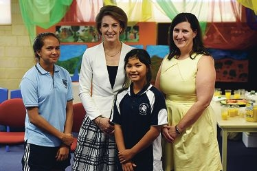 WA Senator Michaelia Cash with Lockridge Primary School students Mikaya Morrison, Ku Ku Panpone and YWCA of Perth president Helen Carvosso. Picture: Marcus Whisson www.communitypix.com.au d427678