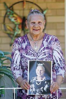 Nyungar elder Oriel Green with her own portrait.