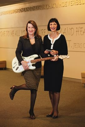 Yasmin Naglazas and Maryanne Bell with an INXS guitar and pearls from Atlas Pearls and Perfumes in Claremont. Maryanne holds Billy Joel's harmonica. Picture: Andrew Ritchie d427316