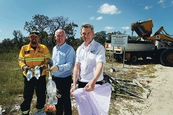 David Posch, Paul Miles and Brett Fitzgerald with dumped rubbish. Picture: Emma Goodwin www.communitypix.com.au d427352