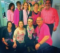 Ellie Faskel with her colleagues on Pink Day to raise funds to help her modify a car.