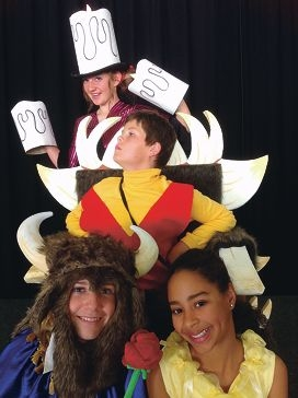 Riley Sneddon (Lumiere), Ryan Drury (Gaston), Tyler James (The Beast) and Jessica Cruikshank (Belle) in Beauty and the Beast.