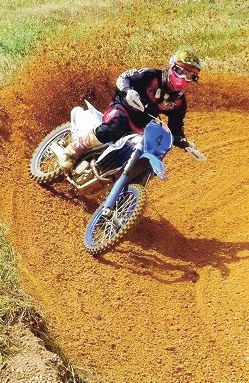 Justin Parker in action during a motorcycle endurance race.