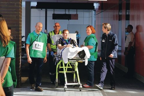 The first patient, Nathan Miller, arrives at the State Rehabilitation Service at Fiona Stanley Hospital from Shenton Park.