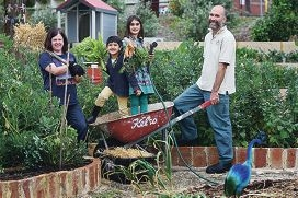 Joondanna Community Food Garden member Nick Mortimer (right) with Lucy Simon and Ibrahim (4) and Saffiya Bhatti (7). Picture: Marcus Whisson d426537