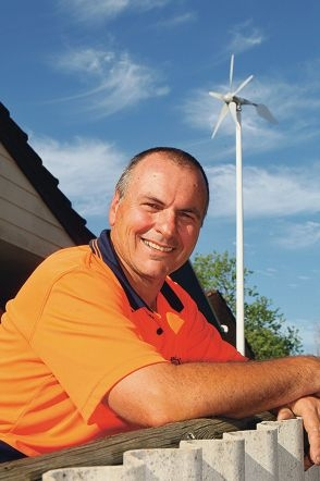 John Muriale with the wind turbine on his property.