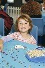 Ava Graham (3) enjoys Ocean Keys Shopping Centre holiday activities. Right: Chantell Humann with Amity (5 ). d426947