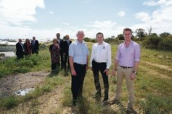 Paul Miles, Jan Norberger and Albert Jacob with members of the freeway working groups in the freeway reserve. Picture: Emma Goodwin
