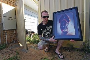 Nick Edmunds with a picture of his dog Beau.Picture: Jon Hewson www.communitypix.com.au d426998