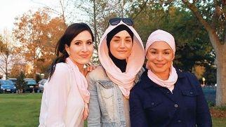 Francesca Bucolo, Sureyya Demir and Ena Jaraba with their pink scarves.