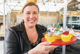 Melanie Babic with her Oz-themed cupcakes.