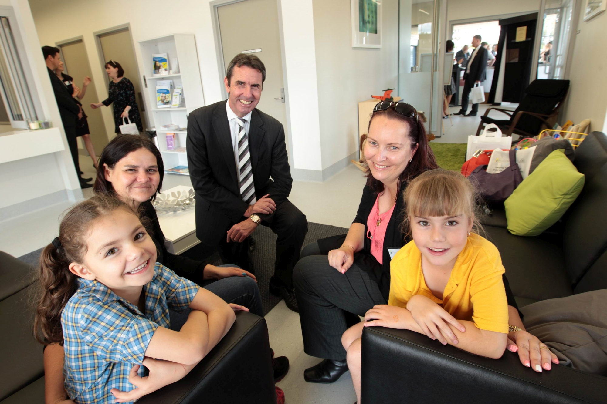 Briony McShade and her daughter Devah (Year 2) with Education Minister Peter Collier and Sabine Huehnerbein and daughter Annalee. d426860a